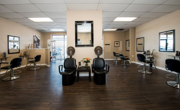Best Hair interior shot of salon with hair dryers